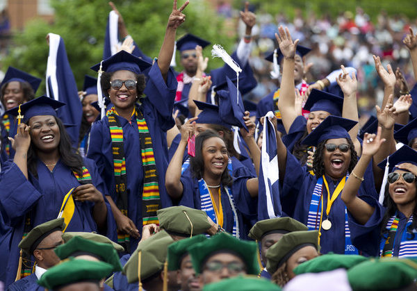 Students cheers as the class of 2014 celebrate during the graduation ceremony at Howard University in Washington, on Saturday, May 10, 2014. Rapper and music mogul Sean Combs delivered the commencement address at Howard University on Saturday. (AP Photo/Jose Luis Magana)