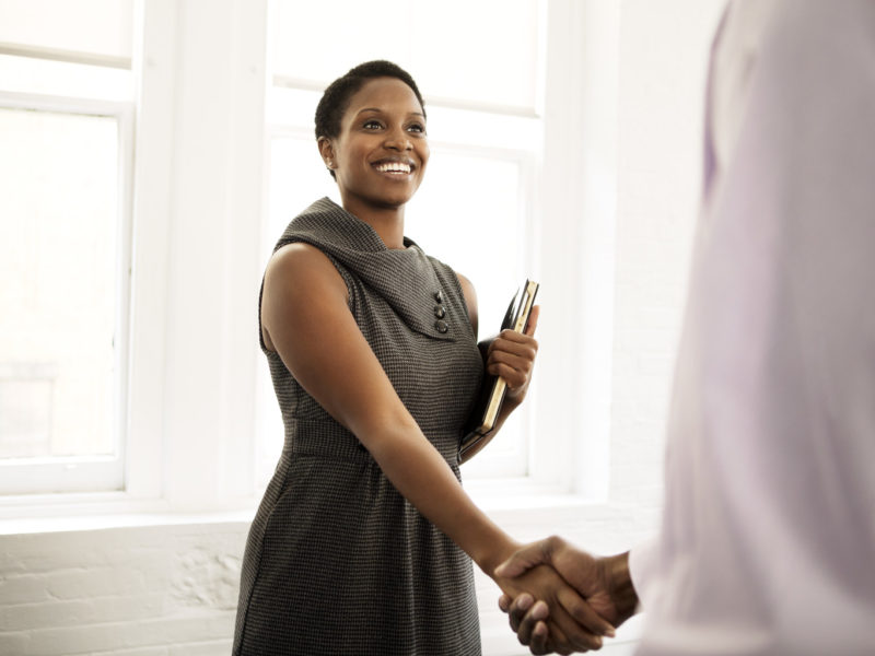 businesswoman shaking hands with client