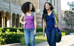 Mixed race college students walking together